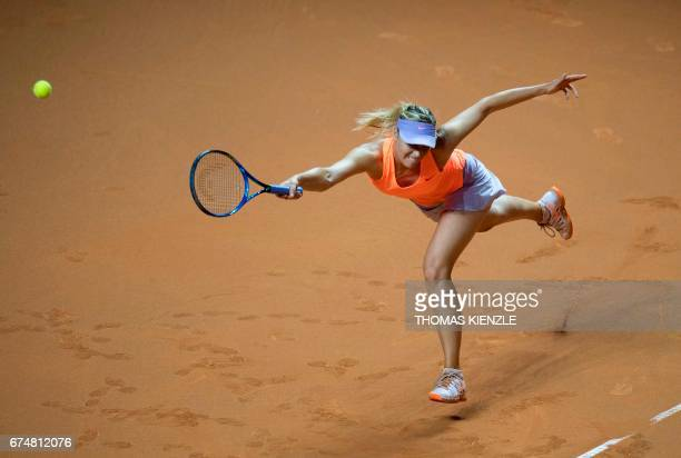 TOPSHOT Russia's Maria Sharapova fails to return the ball to France's Kristina Mladenovic during their semifinal tennis match at the WTA Porsche...