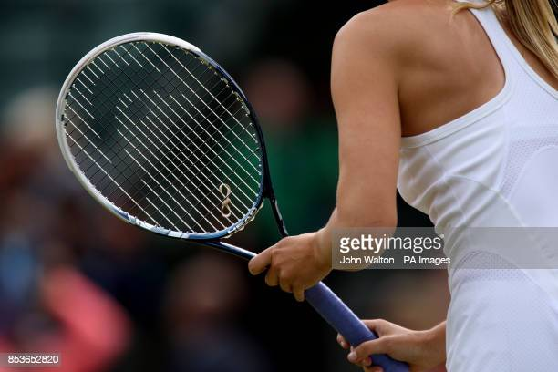 Russia's Maria Sharapova has an elastic band tied onto her racquet strings during her match against Switzerland's Timea Bacsinszky during day four of...