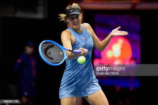 Russia's Maria Sharapova hits a return against Australia's Daria Gavrilova during their match at the St. Petersburg Ladies Trophy tennis tournament...
