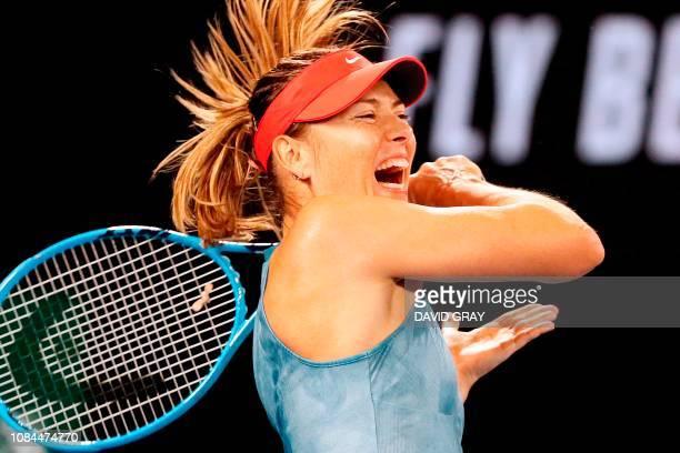 TOPSHOT Russia's Maria Sharapova hits a return against Denmark's Caroline Wozniacki during their women's singles match on day five of the Australian...
