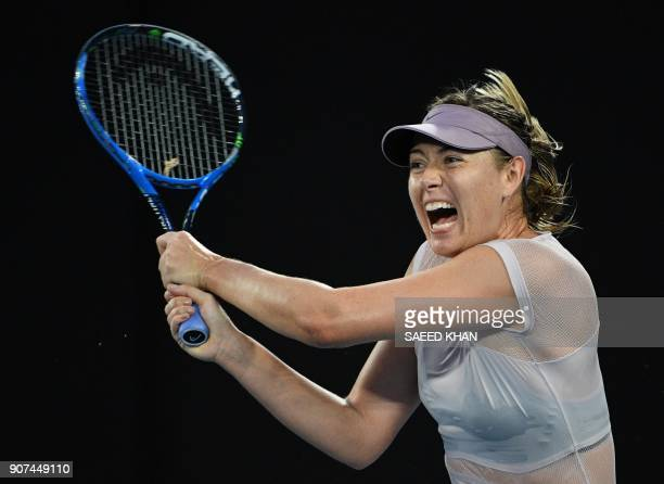 Russia's Maria Sharapova hits a return against Germany's Angelique Kerber during their women's singles third round match on day six of the Australian...