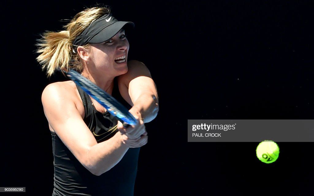 TOPSHOT - Russia's Maria Sharapova hits a return during a tennis training session ahead of the Australian Open tennis tournament in Melbourne on January 11, 2018. /