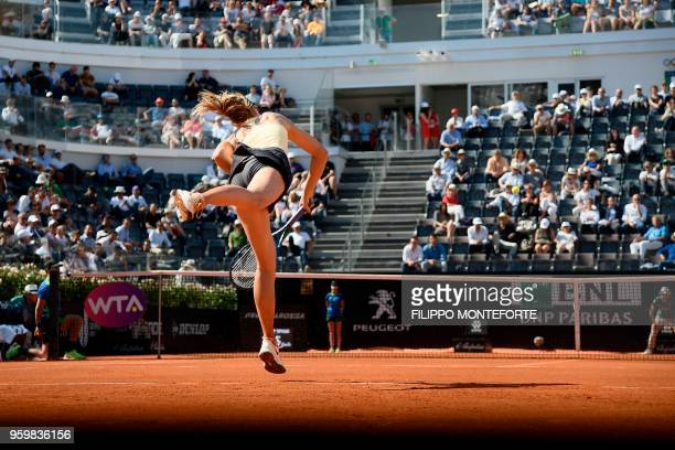 Russia's Maria Sharapova hits a return to Latvia's Jelena Ostapenko during Rome's WTA Tennis Open tournament at the Foro Italico on May 18 2018 in...