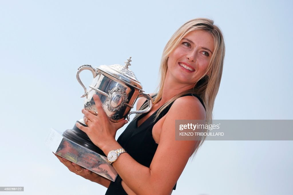 Russia's Maria Sharapova poses with the Suzanne Lenglen trophy in Paris on June 8, 2014 a day after winning the Roland Garros French Tennis Open. AFP PHOTO / KENZO TRIBOUILLARD / AFP PHOTO / Kenzo TRIBOUILLARD