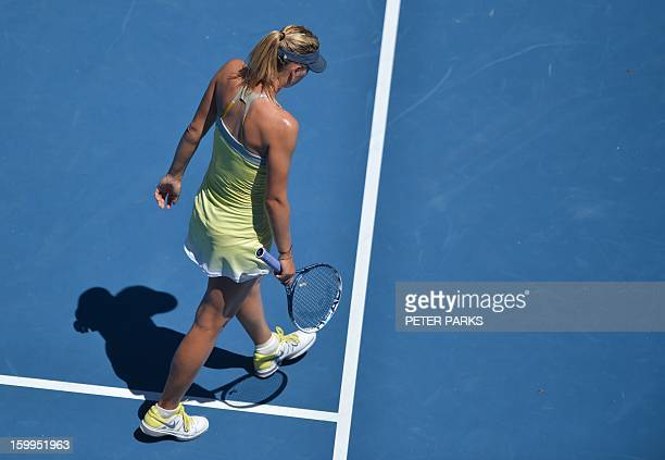 Russia's Maria Sharapova reacts after a point against China's Li Na during their women's singles semifinal match on day 11 of the Australian Open...
