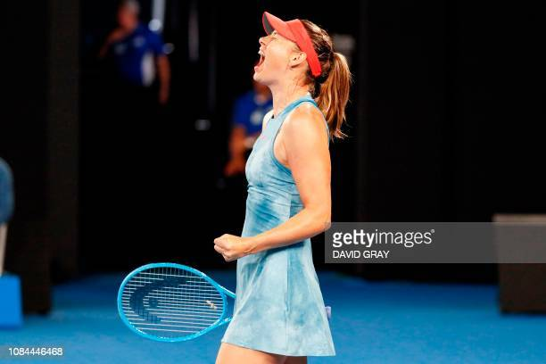 TOPSHOT Russia's Maria Sharapova reacts after a point against Denmark's Caroline Wozniacki during their women's singles match on day five of the...