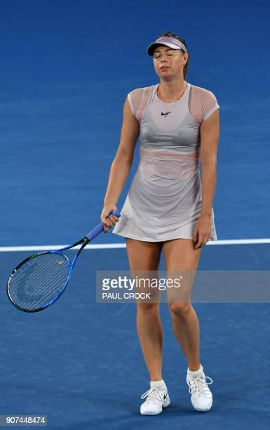 Russia's Maria Sharapova reacts during their women's singles third round match against Germany's Angelique Kerber on day six of the Australian Open...