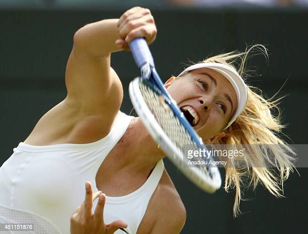 Russia's Maria Sharapova returns the ball to British Samantha Murray during Ladies' Singles first round match of the Wimbledon Lawn Tennis...