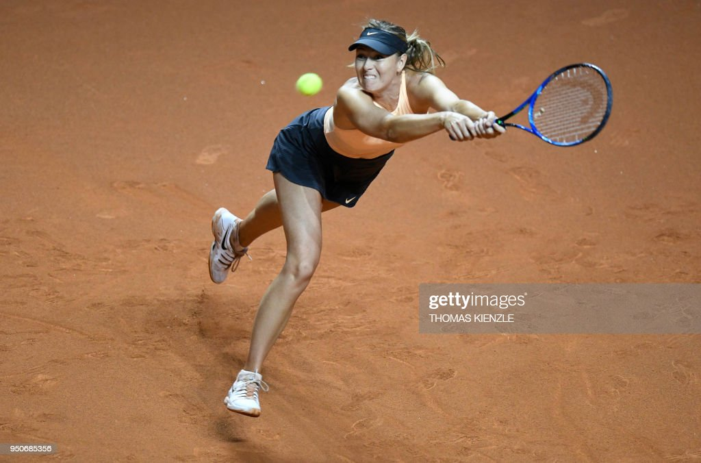 Russia's Maria Sharapova returns the ball to France's Caroline Garcia during their match at the WTA Porsche Tennis Grand Prix in Stuttgart, southwestern Germany, on April 24, 2018.
