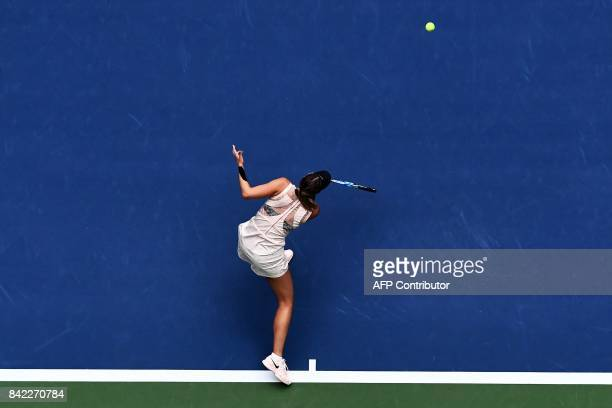 Russia's Maria Sharapova returns the ball to Latvia's Anastasija Sevastova during their 2017 US Open Qualifying Women's Singles match at the USTA...