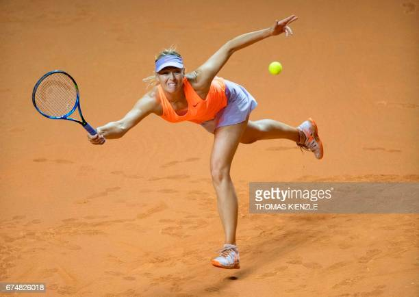 TOPSHOT Russia's Maria Sharapova returns to France's Kristina Mladenovic during their semifinal match at the WTA Porsche Tennis Grand Prix in...
