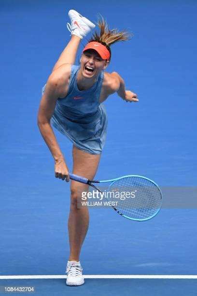 TOPSHOT Russia's Maria Sharapova serves against Denmark's Caroline Wozniacki during their women's singles match on day five of the Australian Open...