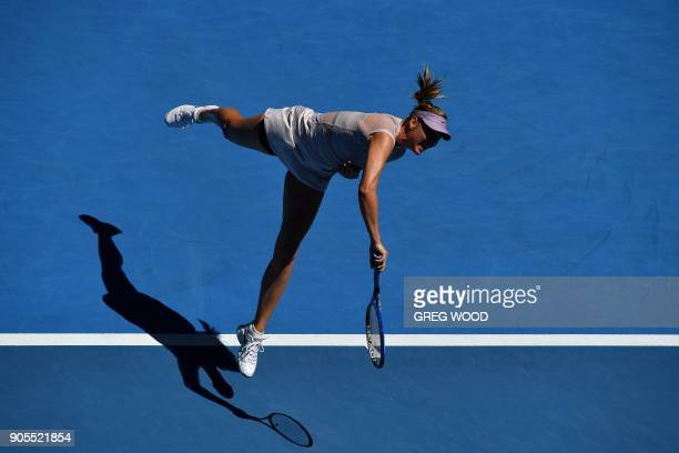 TOPSHOT Russia's Maria Sharapova serves against Germany's Tatjana Maria during their women's singles first round match on day two of the Australian...