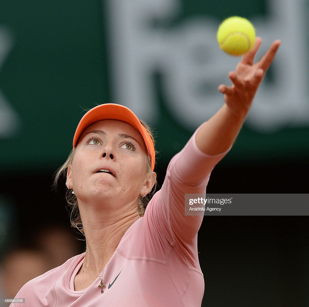 Russia's Maria Sharapova serves against her compatriot Ksenia Pervak on day two of the French Open tennis tournament at Roland Garros Stadium in Paris, France on May 26, 2014.