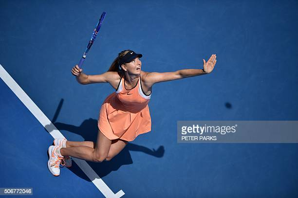 TOPSHOT Russia's Maria Sharapova serves during her women's singles match against Serena Williams of the US on day nine of the 2016 Australian Open...