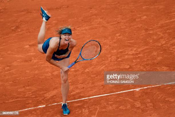 TOPSHOT Russia's Maria Sharapova serves the ball to Netherland's Richel Hogenkamp during their women's singles first round match on day three of The...
