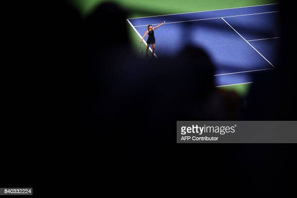 TOPSHOT Russia's Maria Sharapova serves the ball to Romania's Simona Halep during their 2017 US Open Women's Singles match at the USTA Billie Jean...