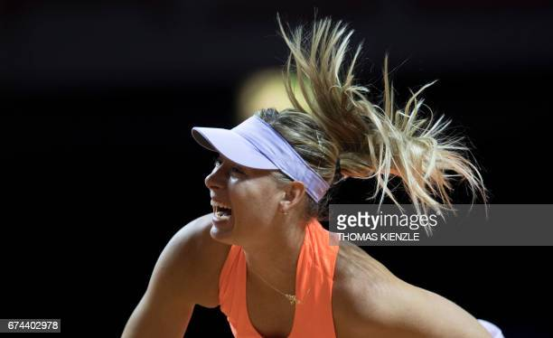 TOPSHOT Russia's Maria Sharapova serves to Estonia's Anett Kontaveit during their quarterfinal match at the WTA Porsche Tennis Grand Prix in...