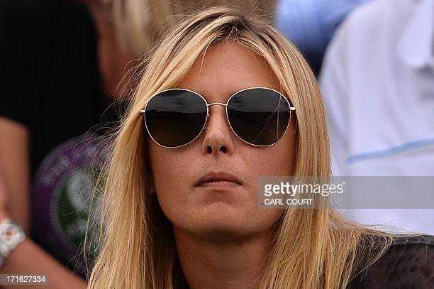 Russia's Maria Sharapova sits in the crowd watching the action between Bulgaria's Grigor Dimitrov and Slovakia's Grega Zemlja during their second...