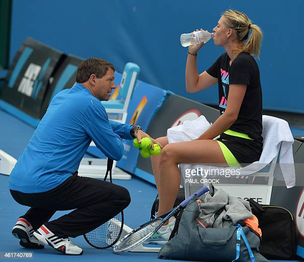 Russia's Maria Sharapova speaks with a coach during a practice session ahead of the 2014 Australian Open tennis tournament in Melbourne on January 11...