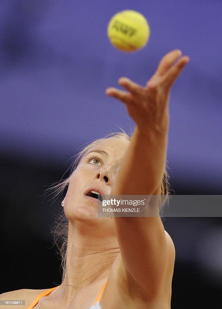 Russia's Maria Sharapova throws the ball to serve against Czech's Lucie Safarova in their match of the WTA Porsche Tennis Grand Prix in Stuttgart, southwestern Germany, on April 25, 2013.