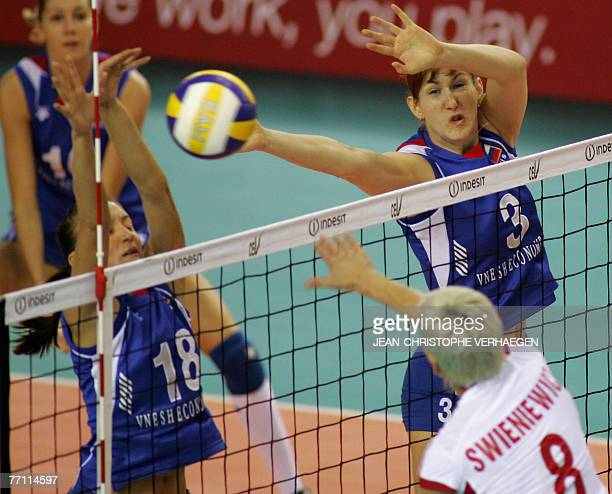 Russia's Marina Akulova and Natalia Sedova block Poland's Dorota Swieniewicz attack during their match for the third place match of the European...
