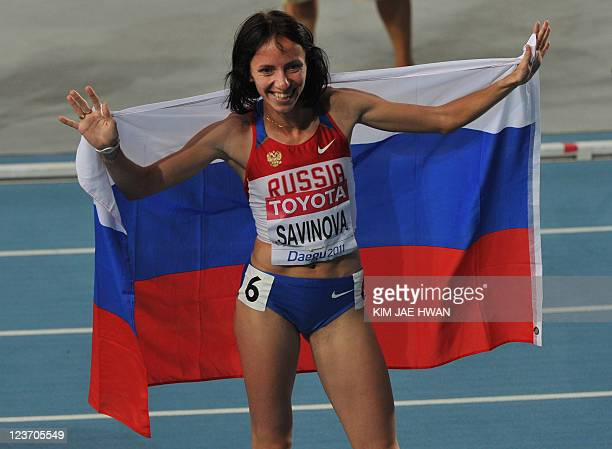 Russia's Mariya Savinova celebrates taking gold in the women's 800 metres final at the International Association of Athletics Federations World...