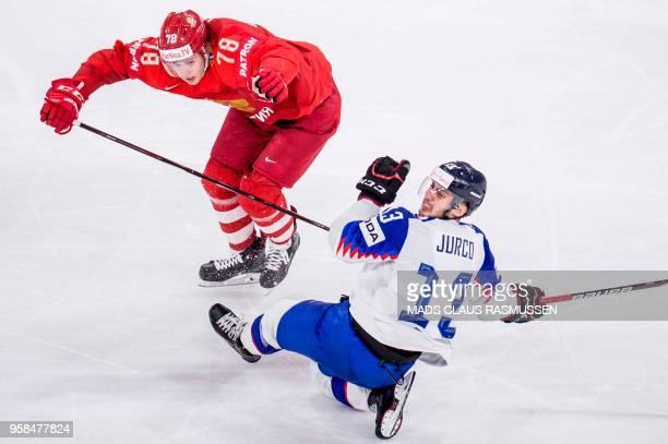 Russia's Maxim Mamin and Slovakia's Tomas Jurco vie during the group A match Russia vs Slovakia of the 2018 IIHF Ice Hockey World Championship at the...