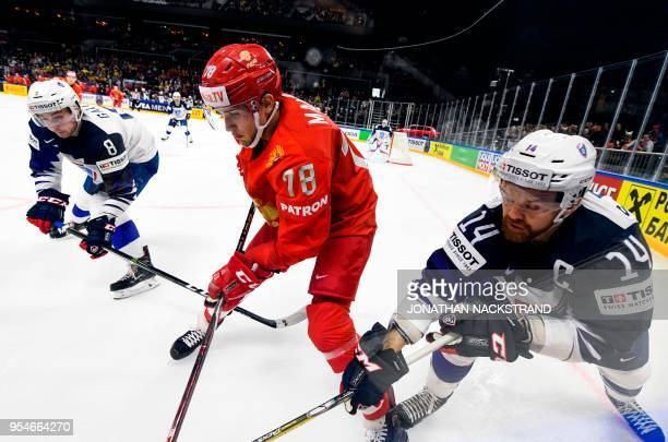 Russia's Maxim Mamin vies with France's Stephane da Costa and France's Hugo Gallet during the 2018 IIHF Men's Ice Hockey World Championship match...