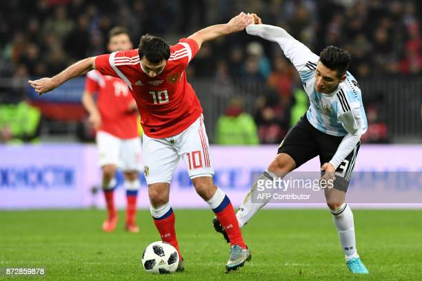 Russia's midfielder Alan Dzagoev and Argentina's Matias Kranevitter vie for the ball during an international friendly football match between Russia...