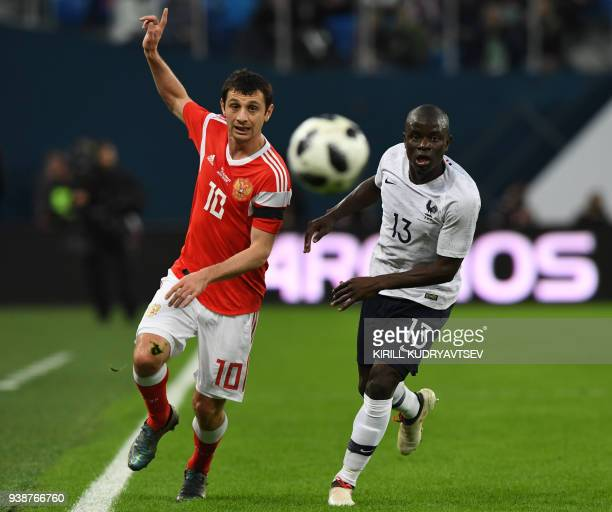 Russia's midfielder Alan Dzagoev and France's midfielder N'golo Kante vie for the ball during an international friendly football match between Russia...