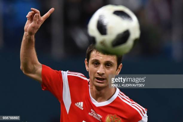 Russia's midfielder Alan Dzagoev gestures during an international friendly football match between Russia and France at the Saint Petersburg Stadium...