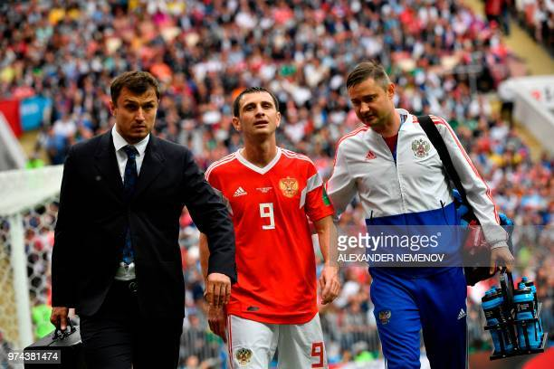 Russia's midfielder Alan Dzagoev goes off injured during the Russia 2018 World Cup Group A football match between Russia and Saudi Arabia at the...