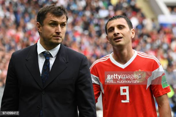 Russia's midfielder Alan Dzagoev leaves the pitch due to an injury during the Russia 2018 World Cup Group A football match between Russia and Saudi...