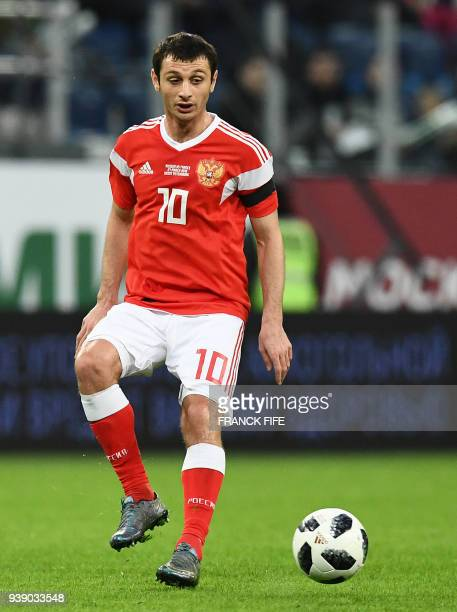 Russia's midfielder Alan Dzagoev passes the ball during the friendly football match between Russia and France at the Krestovski stadium in St...