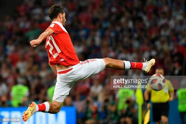 TOPSHOT Russia's midfielder Aleksandr Erokhin in action during the Russia 2018 World Cup quarterfinal football match between Russia and Croatia at...