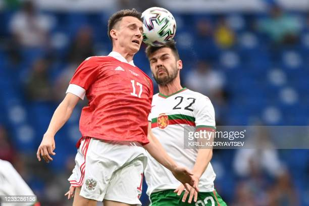 Russia's midfielder Aleksandr Golovin and Bulgaria's midfielder Petar Vitanov vie for the ball during the friendly football match Russia v Bulgaria...