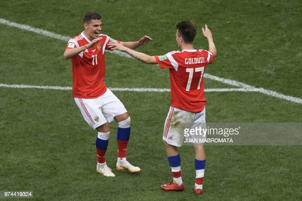 Russia's midfielder Aleksandr Golovin celebrates his goal with Russia's midfielder Roman Zobnin during the Russia 2018 World Cup Group A football...