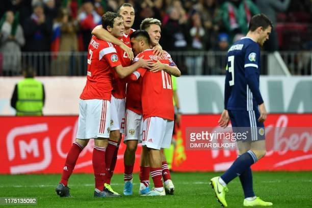 Russia's midfielder Aleksandr Golovin celebrates with teammates after scoring the team's fourth goal during the Euro 2020 football qualification...