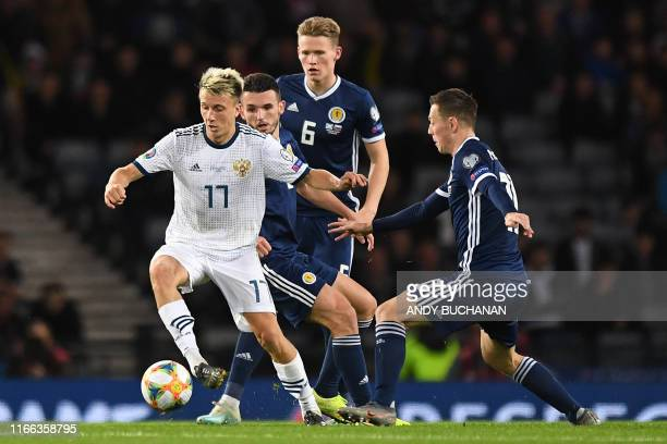 Russia's midfielder Aleksandr Golovin controls the ball during the UEFA Euro 2020 Qualifying 1st round Group I football match between Scotland and...