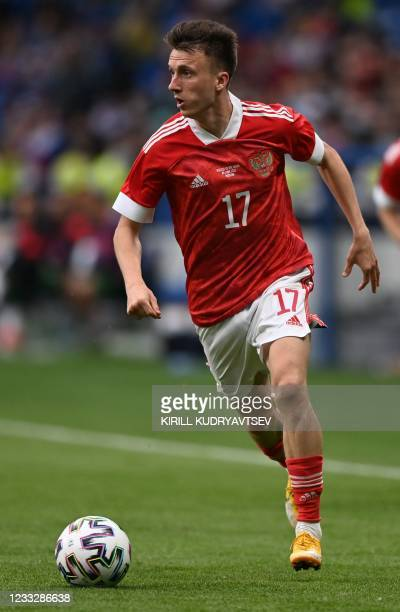 Russia's midfielder Aleksandr Golovin controls the ball during the friendly football match Russia v Bulgaria in Moscow on June 5 in preparation for...