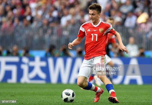 Russia's midfielder Aleksandr Golovin controls the ball during the Russia 2018 World Cup Group A football match between Russia and Saudi Arabia at...