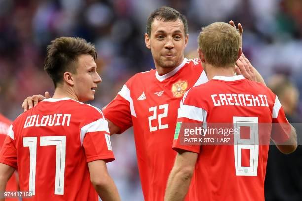 Russia's midfielder Aleksandr Golovin is congratulated by teammates for scoring his team's fifth goal during the Russia 2018 World Cup Group A...