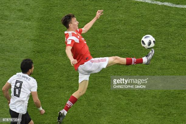 Russia's midfielder Aleksandr Golovin stretches to reach the ball during the Russia 2018 World Cup Group A football match between Russia and Egypt at...