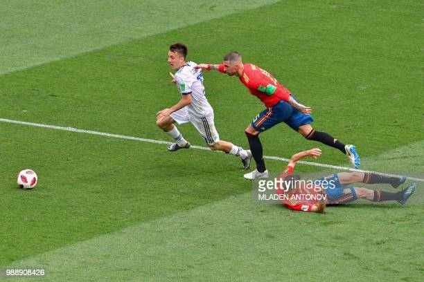 Russia's midfielder Aleksandr Golovin vies for the ball with Spain's defender Sergio Ramos during the Russia 2018 World Cup round of 16 football...