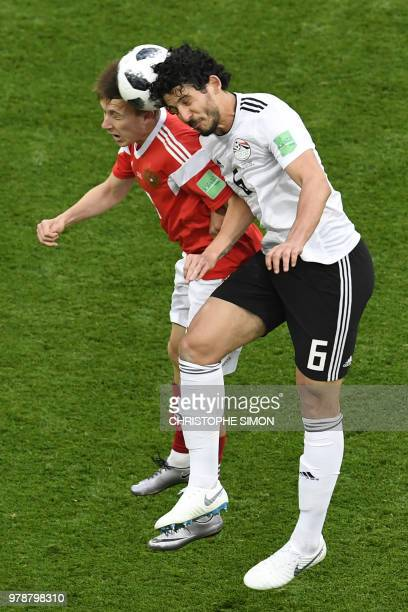 Russia's midfielder Aleksandr Golovin vies for the header with Egypt's defender Ahmed Hegazi during the Russia 2018 World Cup Group A football match...