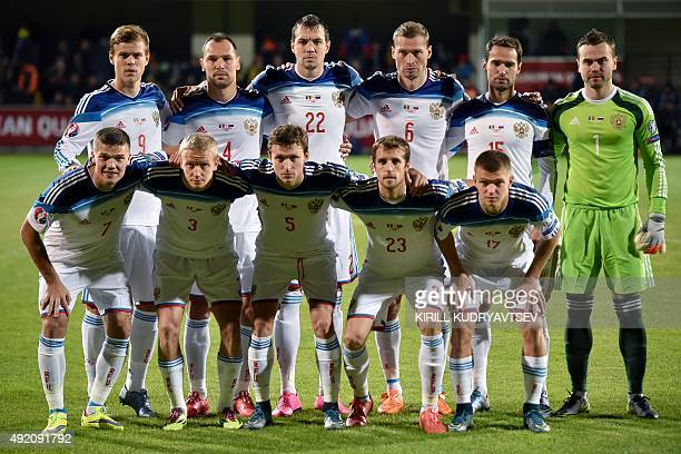 Russia's midfielder Aleksandr Kokorin defender Sergei Ignashevich forward Artyom Dzyuba defender Aleksei Berezutski midfielder and captain Roman...