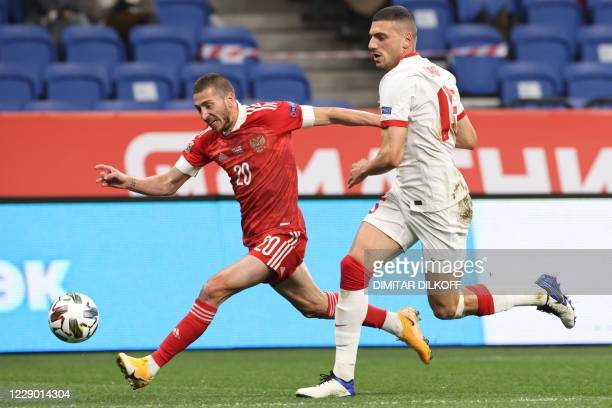 Russia's midfielder Aleksey Ionov and Turkey's defender Merih Demiral vie for the ball during the UEFA Nations League football match between Russia...