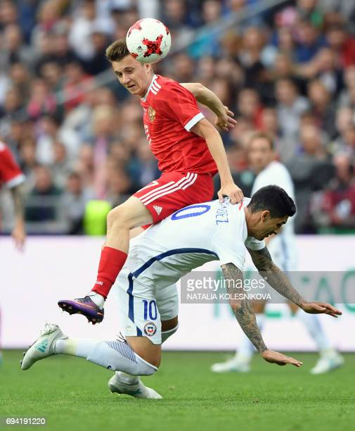 Russia's midfielder Alexander Golovin and Chile's midfielder Pablo Hernandez vie for the ball during a friendly football match between Russia and...