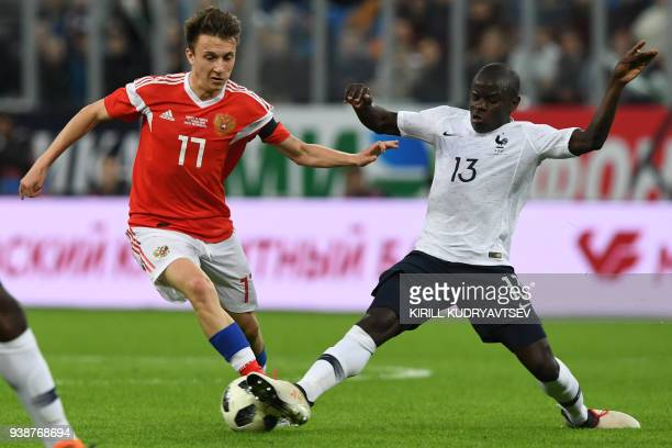 Russia's midfielder Alexander Golovin and France's midfielder N'golo Kante vie for the ball during an international friendly football match between...